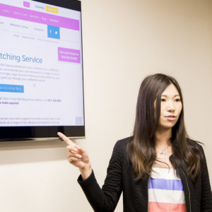 asian_woman_presenting_SHARE